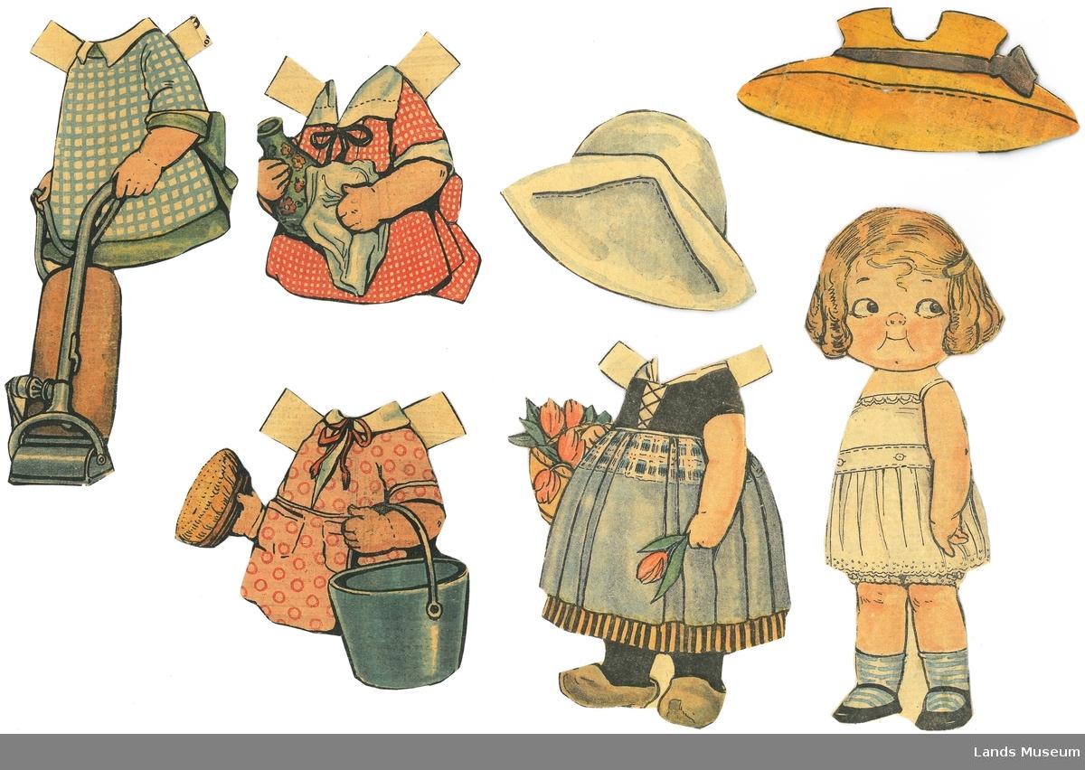 Papirdukke med klær som er klipt ut frå avis/magasin. Dukken er montert på papp. Klær med hage og husholdningsmotiv.  A- dukke, jente med lyst hår med spenne, 20 x 7,5 cm B- hollenderdrakt med tresko, 14 x 10 cm C- hatt til drakt B, kvit og blå, 7 x 11 cm D- kjole med bøtte og børste, rosa, 10,5 x 11 cm E- rødrutetet kjole med vase og klut, 9 x 8 cm F- grønn kjole med blårutet forkle og støvsuger, 18 x 8 cm G- hatt, med brunt bånd, 5 x 13 cm