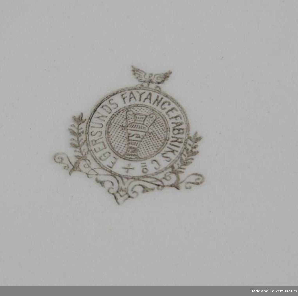 Ovalt fat. Grønt stempel fra ca. 1885-1910