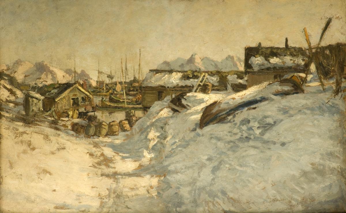 Nordnorsk landskap med båter og boder i et snødekket fiskevær i Lofoten.