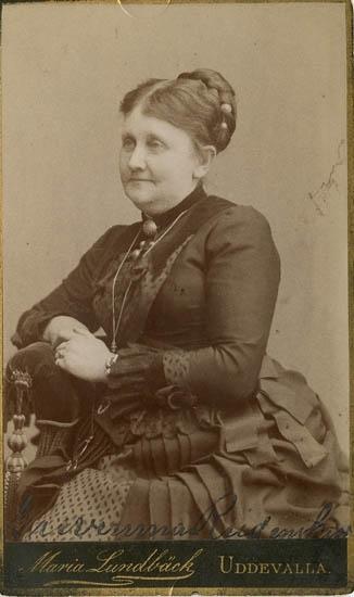 """Text på kortets baksida: """"Sara Euphroyne Gunilla Rudenskiöld f. 1825 d. 1896""""."""