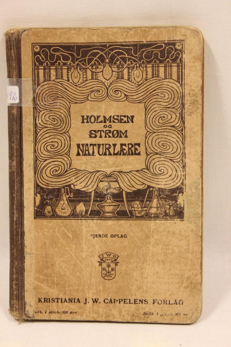 Lærebok. Tittel: HOLMSEN OG STRØM NATURLÆRE. Fjerde opplag. Kristiania J.W. Cappelens forlag. Boken er trykket i 1910. Inne i permen står skrevet navnene: