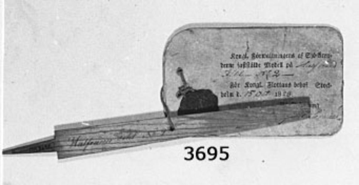 Fil, halvrund. Modell av trä med vidhängande fastställelsebricka. Sigill fastställd den 15 okt 1828