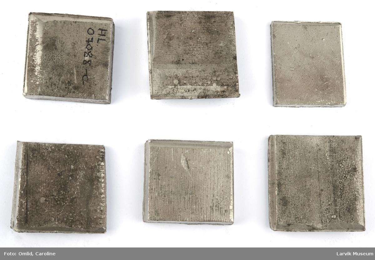 4 kvadratiske nikkelstykker
