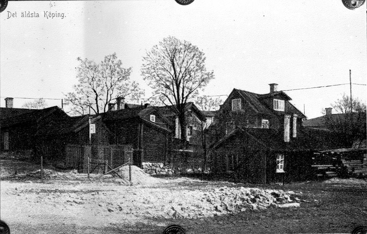 Den äldre bebyggelsen vid Västra Långgatan före år 1900.  Fotograf okänd.  Fotokopia finns.