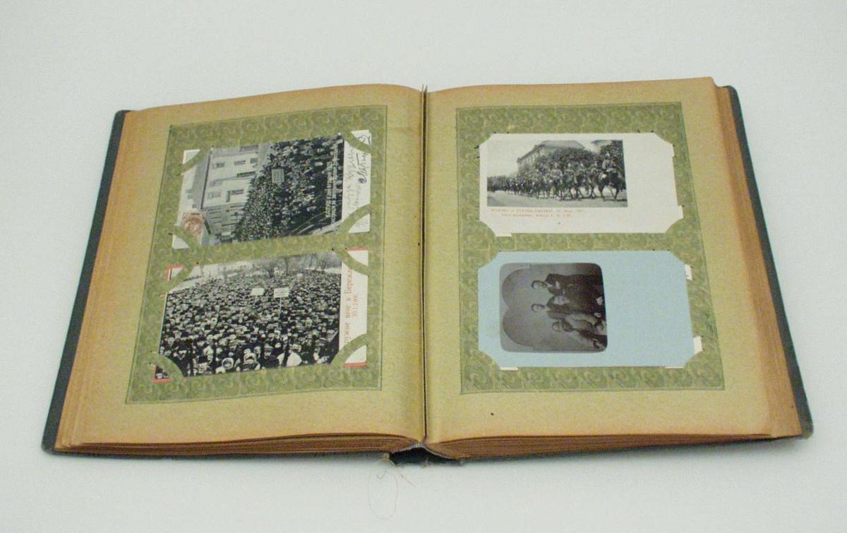 Samling av kort i album med blant andre politiske og folkoristiske motiv. Omslaget har jugendstil.
