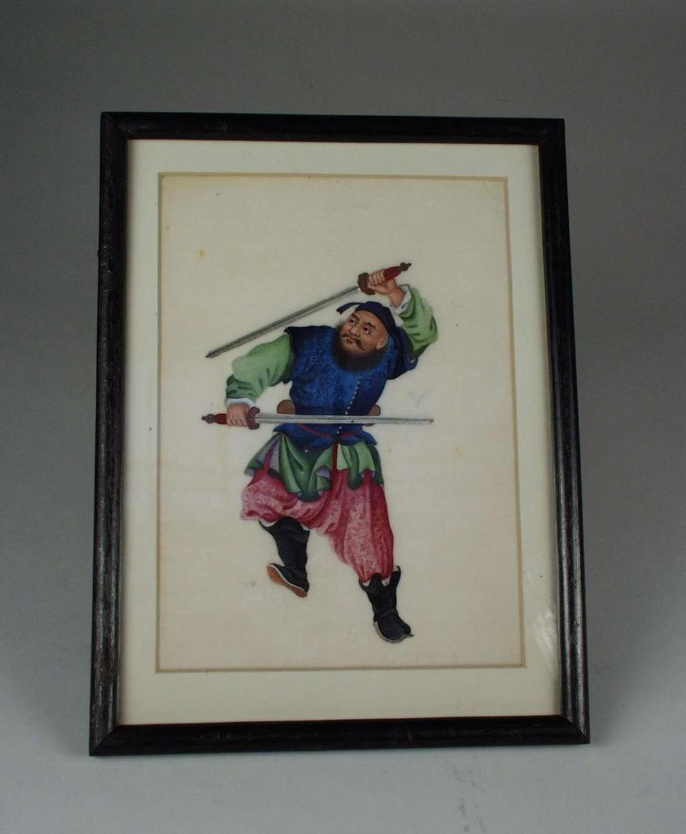 Kinesisk/mongolsk sverdsvinger i fargerike silkeklær.