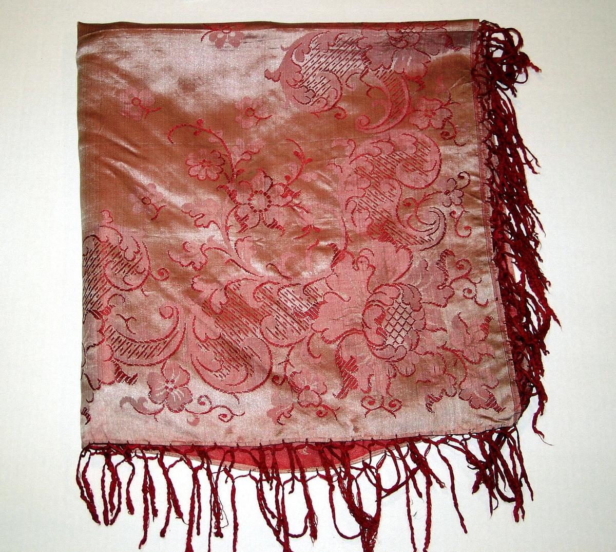 Hodetørkle i rødt og gulhvitt mønster, damask. Påknytte frynser.