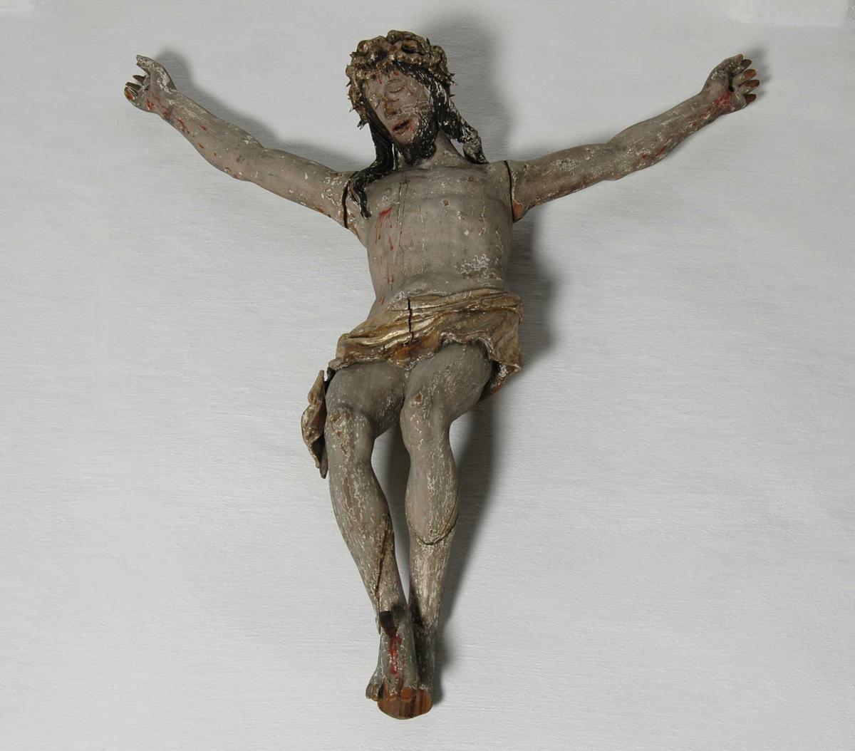 Den lidende Kristus i korsfestelsesposisjon. Forgylt lendeklede og tornekrone.