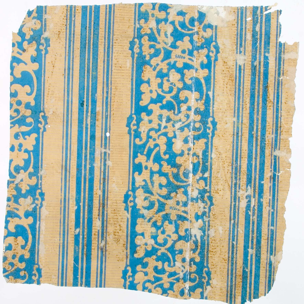 Tapetprov med tryckt mönster  i färgerna blått och gult.