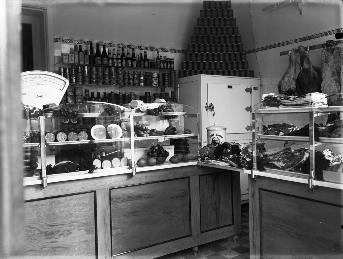 Sannolikt Brunnbergs köttaffär, kvarteret Vallhall, Skolgatan, Uppsala 1933
