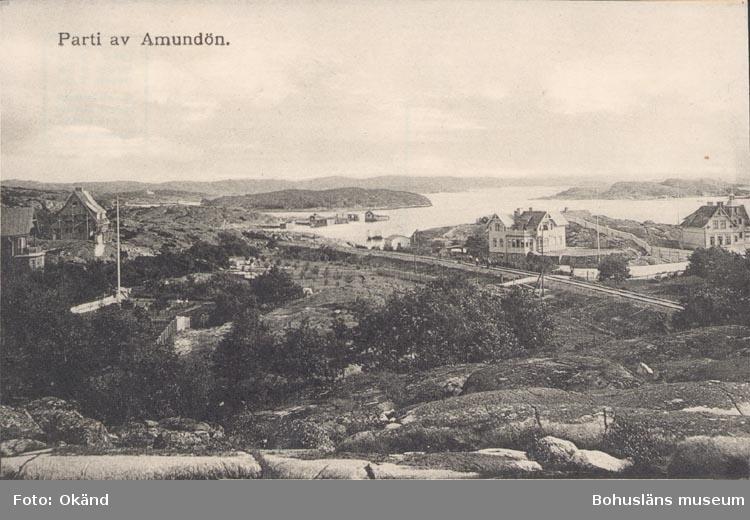 """Tryckt text på kortet: """"Parti av Amundön""""."""