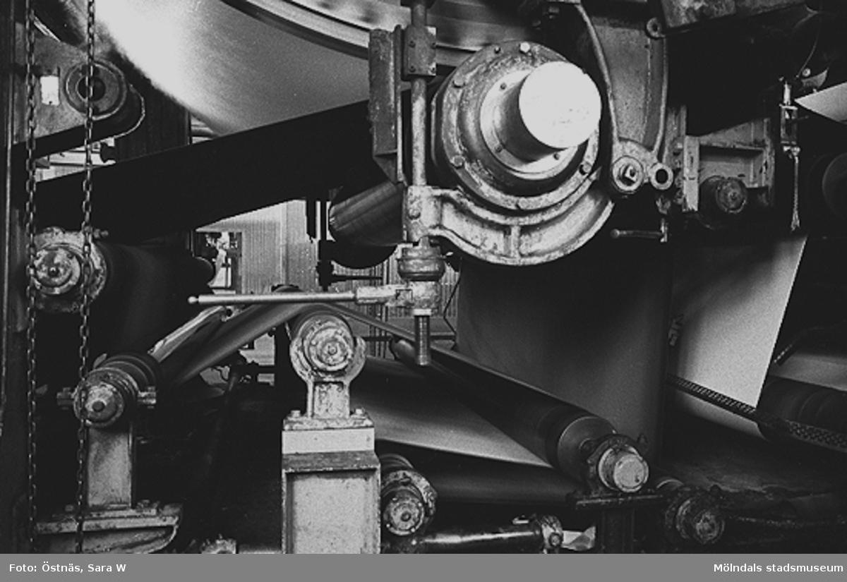 Detalj av en maskin för papperstillverkning.