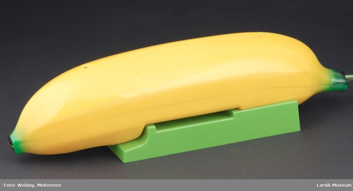 Form: Banan. Telefon og tastatur i sammen.