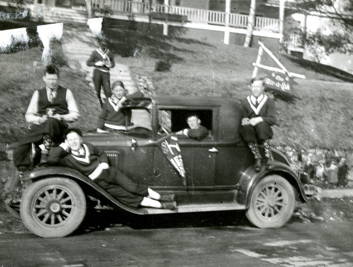 The Norwegian ski jumping team and a car