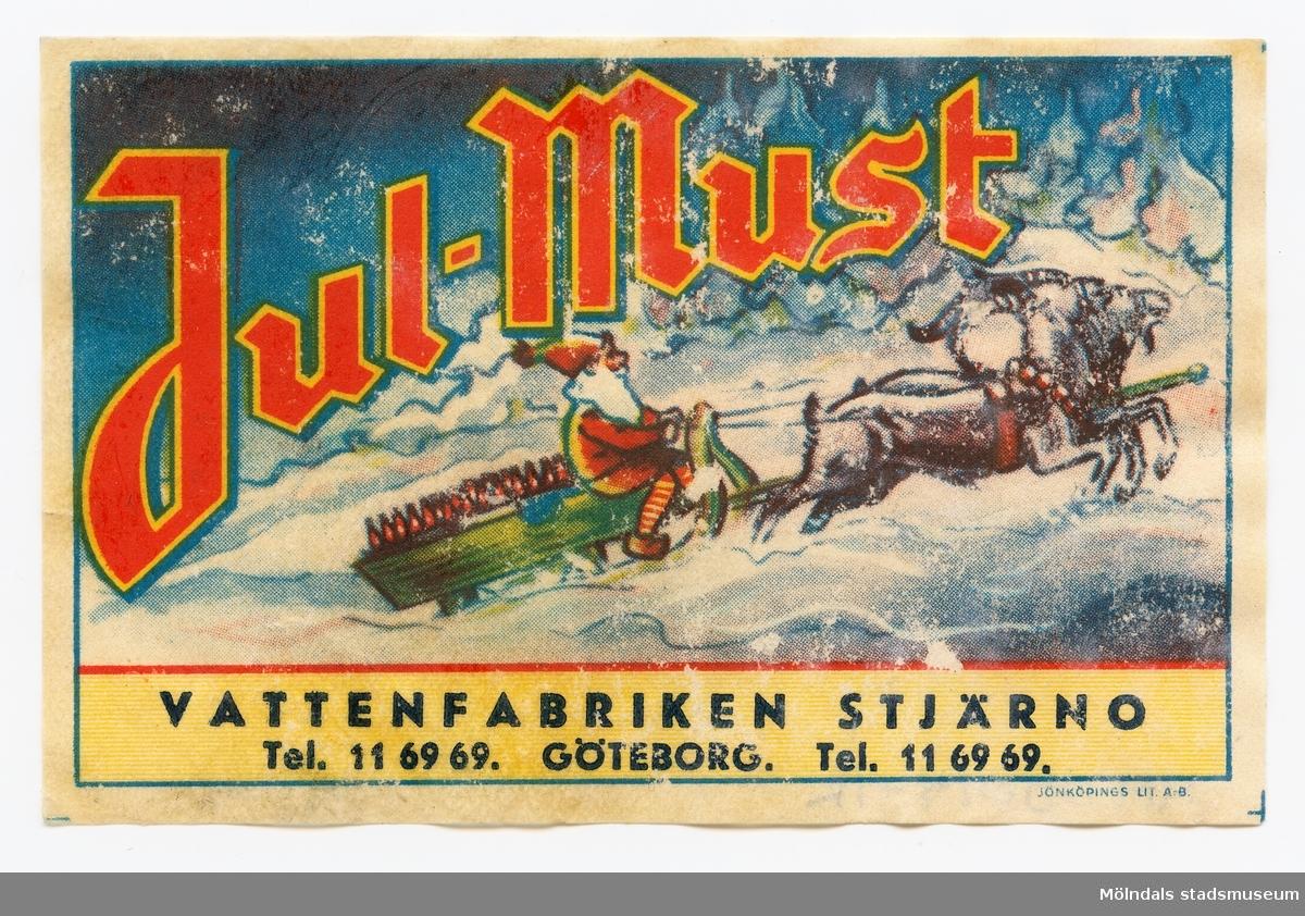 Etikett med texten Jul-must  Vattenfabriken Stjärno Tel. 116969. Göteborg.  Tel. 1169  Ingår i samling av 14 etiketter från Vattenfabriken Stjärno.