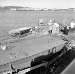 Bildet viser kaia og piren på Storviks Mek. Verksted og er t