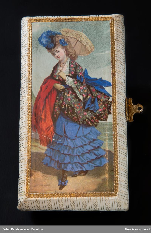 Kungaparets porträtt, ett foto, är klistrat på karamellen, b.
