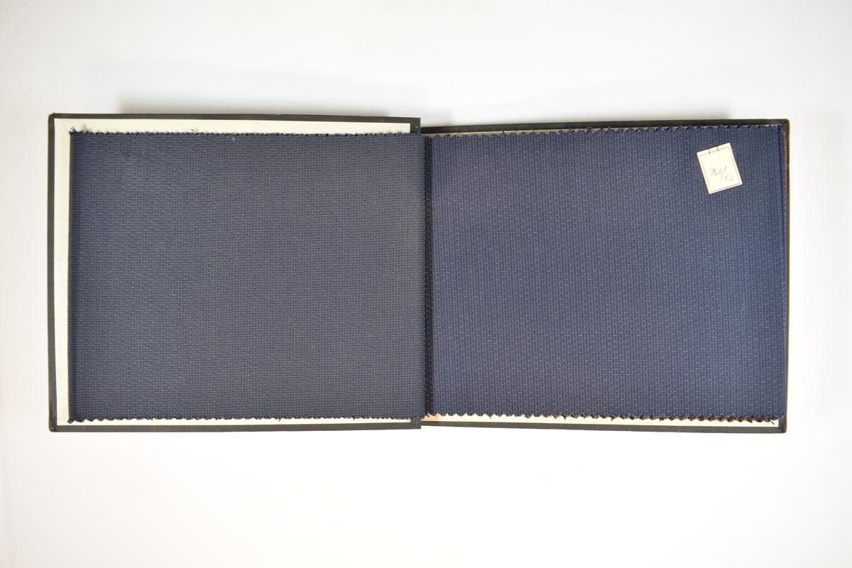 Prøvebok med 9 stoffprøver. Relativt tynt stoff med striper og prikker av ulike slag. Stoffet ligger brettet dobbelt i boken slik at vranga dekkes. Stoffet er merket med en firkantet papirlapp, festet til stoffet med metallstifter, hvor nummer på påført for hånd.   Stoff nr.: 766/91, 766/92, 766/93, 766/94, 766/95, 766/96, 766/97, 766/98, 766/99.