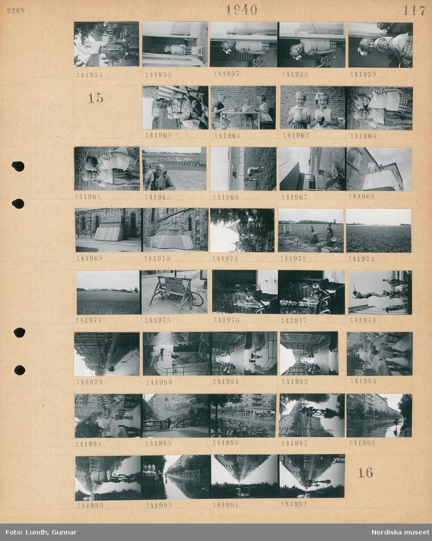 """Motiv: (ingen anteckning) ; En man med cykel står framför en kyrka, en flicka med dockvagn står i en dörröppning.   Motiv: (ingen anteckning) ; En kvinna sitter i en solstol, en pojke och en flicka och ett barn sitter vid ett bord och äter, porträtt av en pojke och en flicka, porträtt av en flicka och en man, exteriör av hus med solstolar, en person står på en balkong, en kyrka med skydd av trä, kvinnor och män arbetar på en åker, vy över en odling, en skylt """"A-B. Nils P. Lundh Malmö"""", män och kvinnor vid en bil, en fontän med skulpturer, stadsvy med regvåt gata, gatuvy med fotgängare med paraply och en lastbil, en cyklist på en regnvåt gata."""