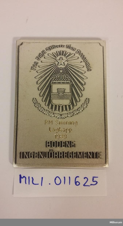 Prisplakett i valören silver (försilvrad brons).