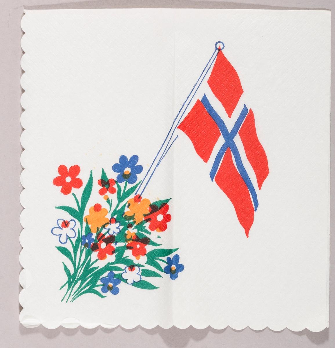 Et norsk flagg og blomster i mange farger.