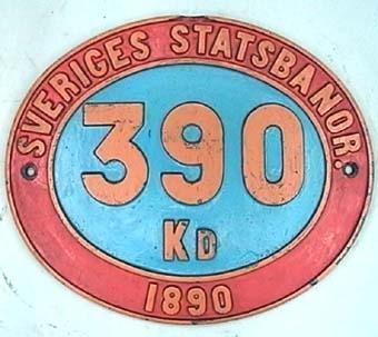Skylt från ångloket SJ Kd 390, Kd2 (1901), 1929 till JVM NOHAB Nº 300  Modell/Fabrikat/typ: Blå mitt, röd kant och gul text
