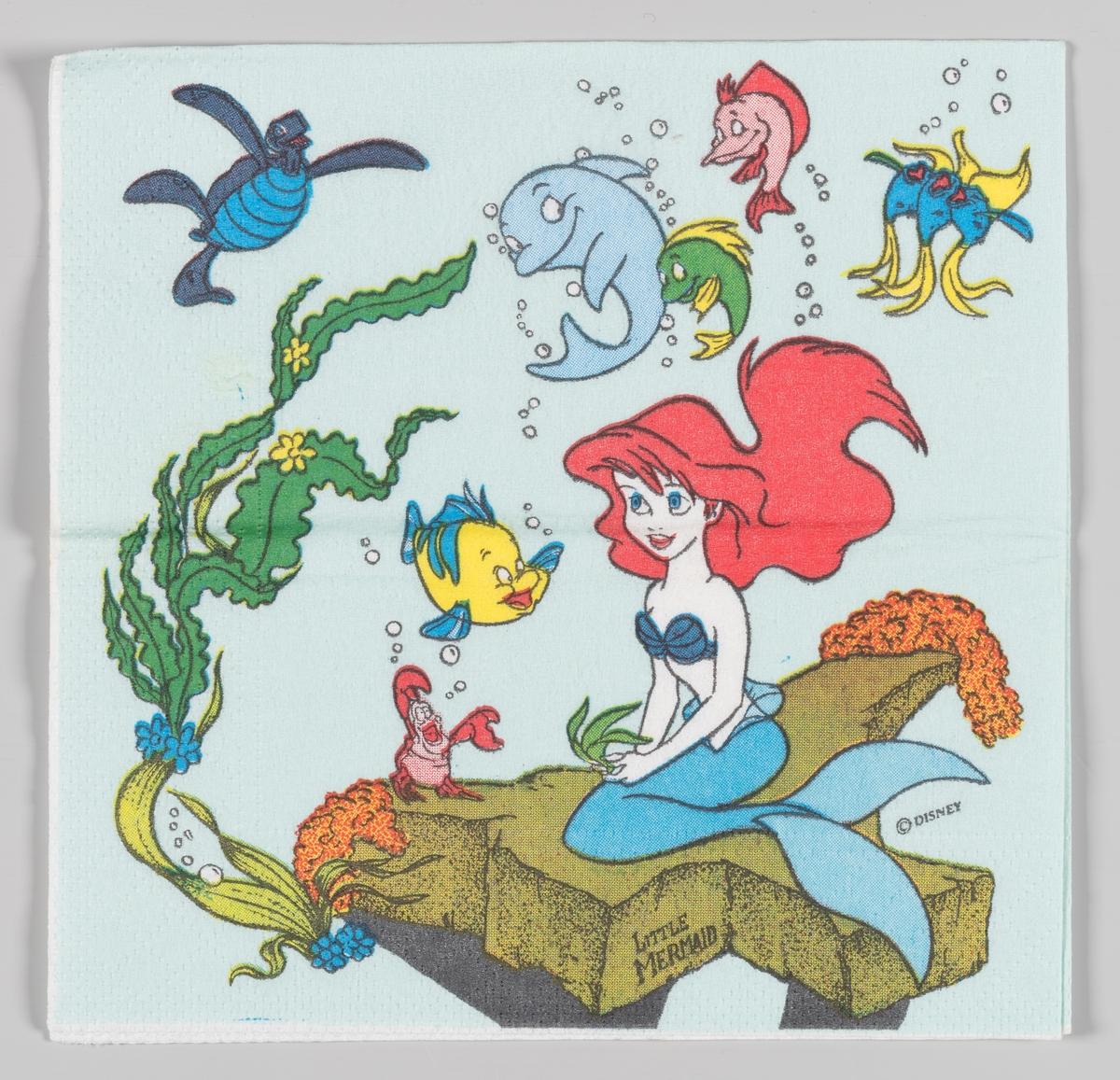 Den lille havfrue sitter mens dyrene fra tegnefilmen svømmer rundt henne  Walt Disney animasjonfilmen Den lille havfruen kom i 1989.