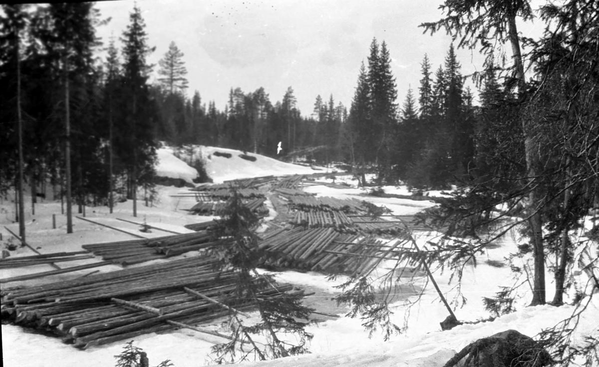 Oppsamlindsplass for tømmer.Vinter.