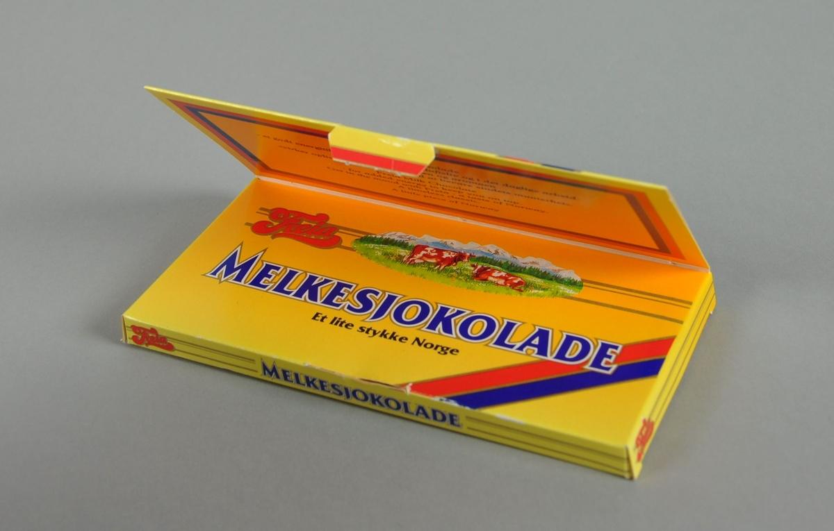 Etui av papp, til oppbevaring av sjokolade. Farget motiv fra Maihaugen, stasjonsbygningen i Lillehammer og hoppbakken på framsiden. Esken har flatt lokk som festes på framsiden.