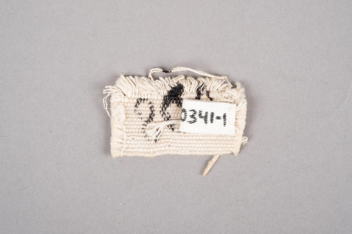 Merkelapp med fangenummer.
