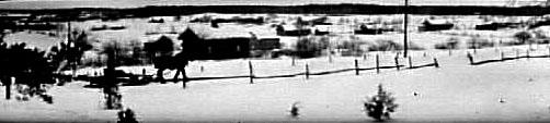 Vinterlandskap med häst och släde på landsvägen vid Låstad.