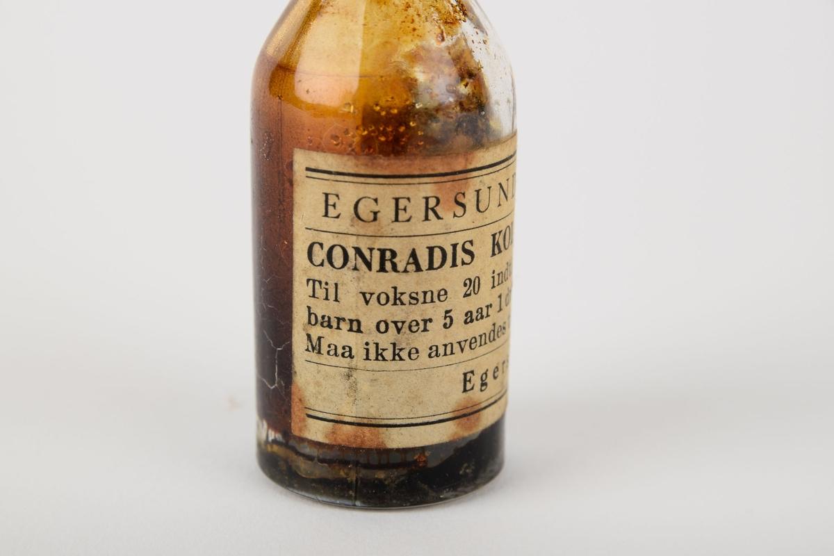 Medisinflaske med koleradråper fra Egersund Apotek. Koleradråper ble brukt mot diaré og magesmerter.