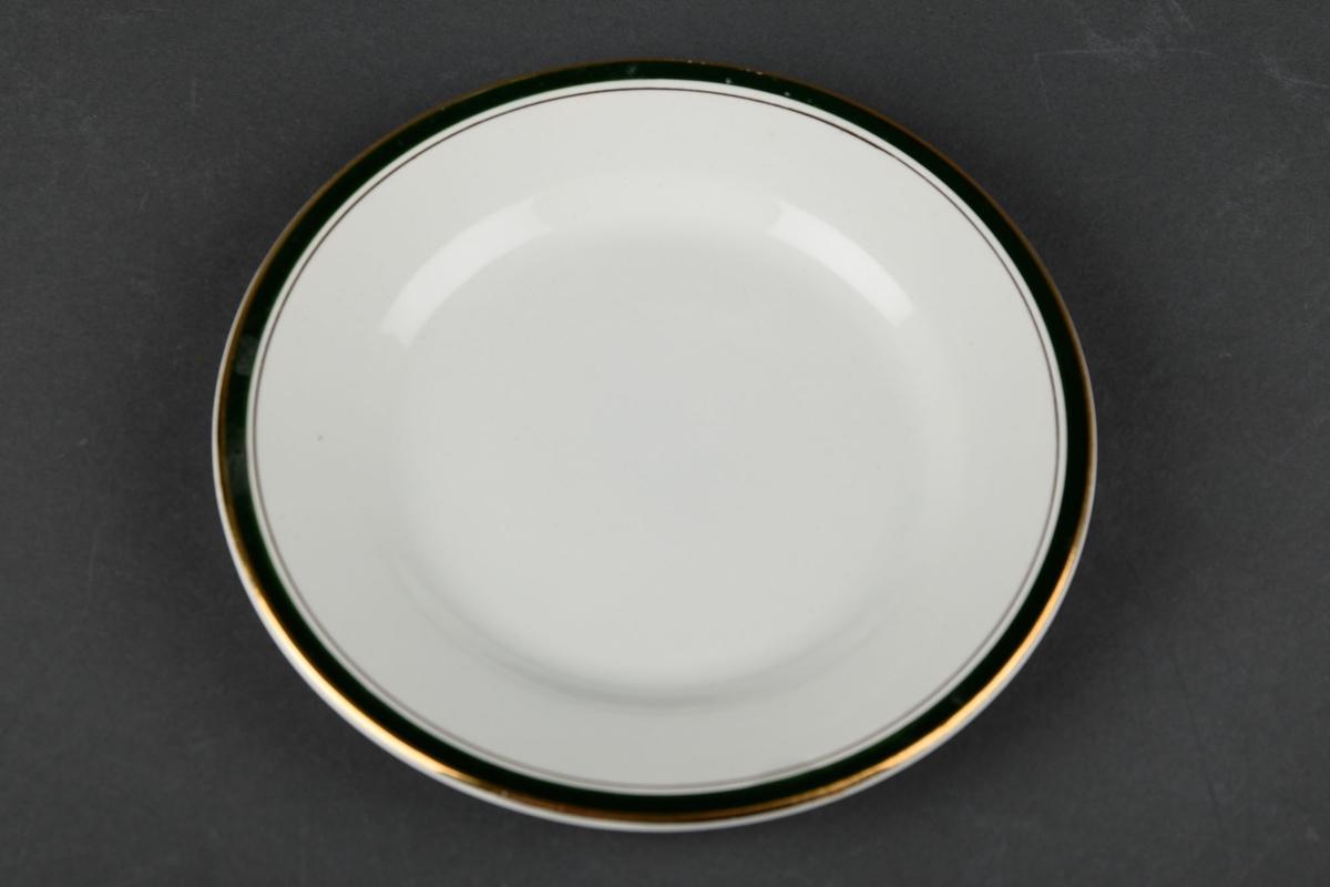 1 hvit tallerken, dekorert med en grønn og gull sirkel langs kanten.