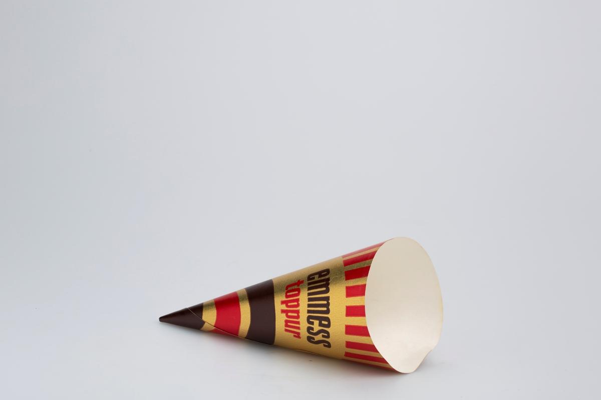Kjegleformet iskrempapir (kremmerhus) i aluminium. Kremmerhuset er med farger på utsiden, og matt uten farge (hvit) på innsiden. Kremmerhuset er dekorert med rette og bølgete linjer i gull, rødt og brunt. Rette linjer på toppen av kremmerhuset og bølgete linjer i nedre del av kremmerhuset. Et gullbelte med skrift deler de to partiene.