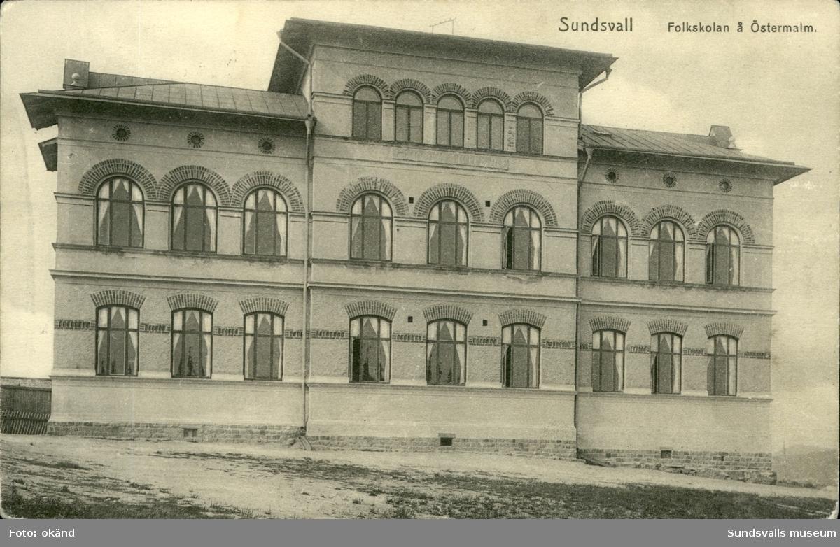 Vykort med motiv över Folkskolan i Sundsvall.