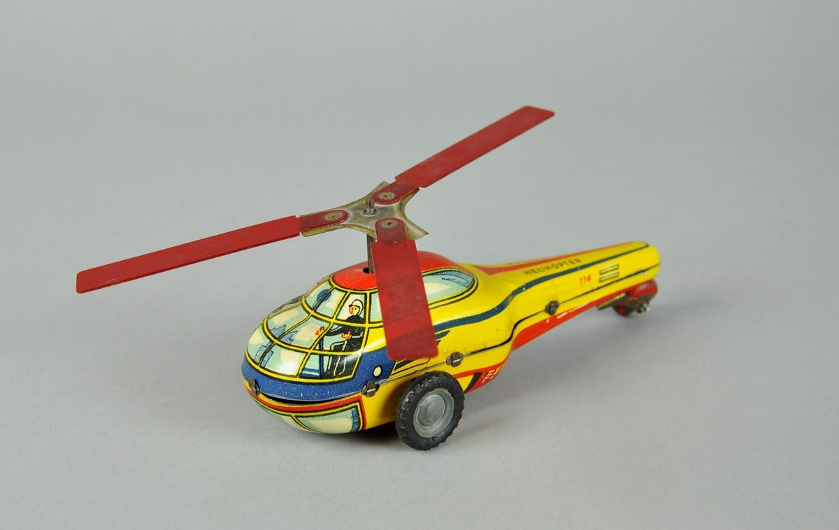 Helikopter av blikk med to hjul under flykroppen og et hjul under halen. Helikopteret har 3 rotorblader.