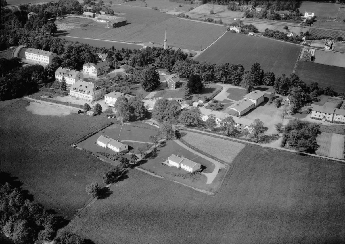 Flygfoto över Vilhemsro utanför Jönköping, Jönköpings kommun. Nr 1068/1961