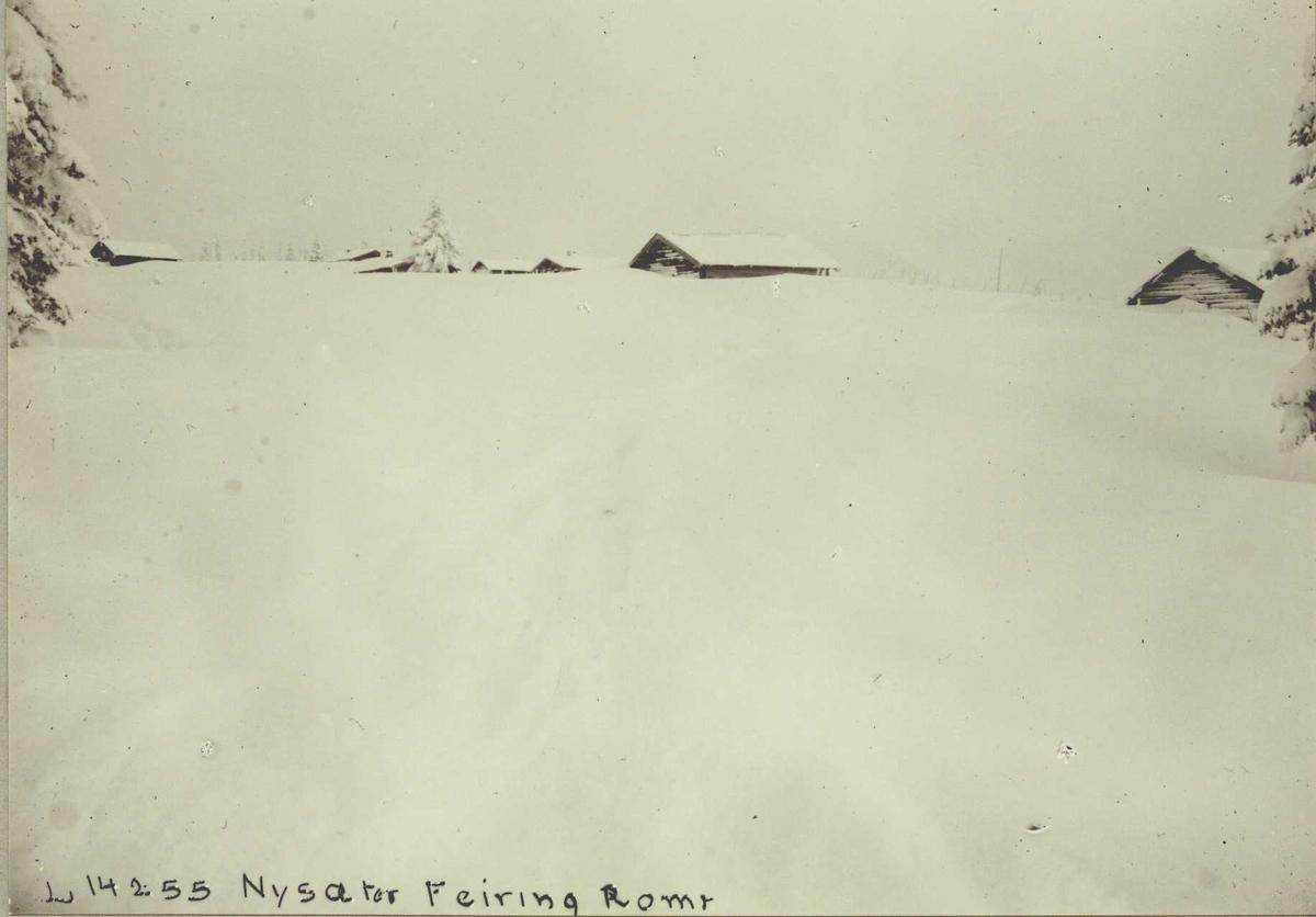 Nyseter, Feiring, Eidsvoll, Akershus. Seterhus stikker opp av snø.