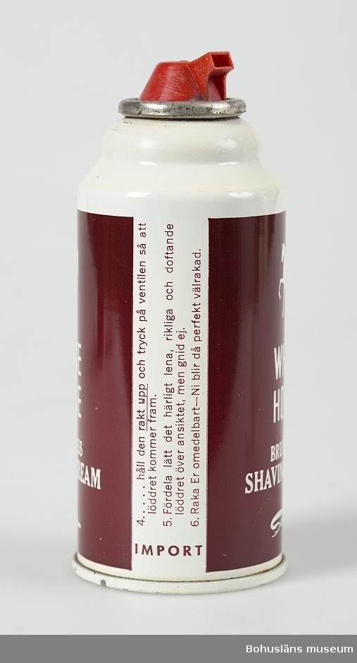 """Sprayburk för rakskum märkt: """"White Horse Brushlesss Shaving Cream"""" av fabrikatet Seger.  Med en vit häst på brun etikett.  UMFF 37:1"""