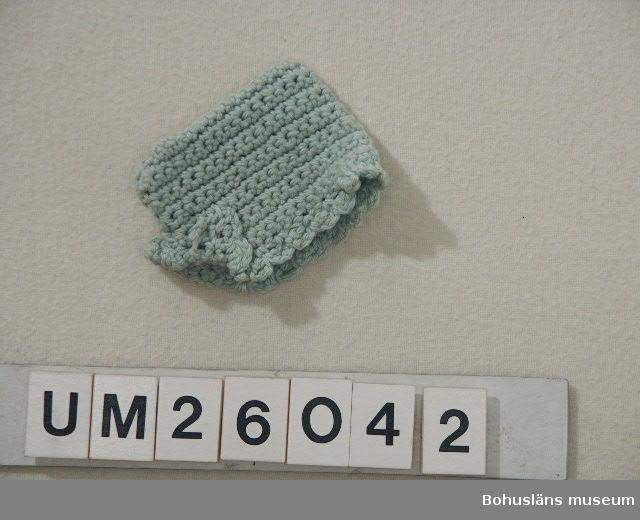 Ljusgrönt bomullsgarn. Person-och släktuppgifter se UM026024