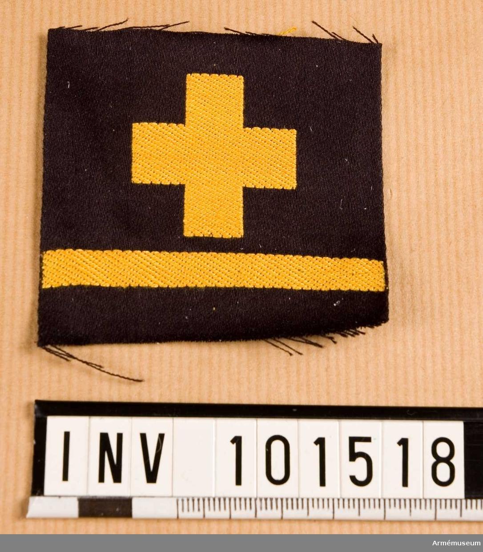 Gradbeteckning: Sjukvårdare, stamanställd, II klassens sjöman, marinen.