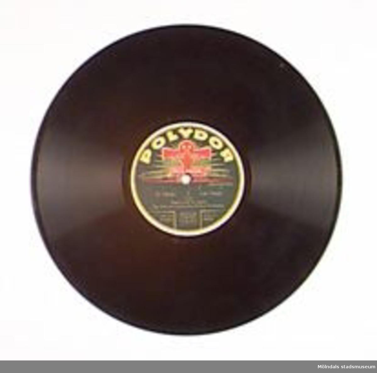 """Anahuac (Haro) Marsch The Efim Schachmeister-Dance-OrchesterDer Fasan Valse (Miguel Lerdo de Tejada) The Efim Schachmeister-Dance-Orchester.Märkt: """"Polydor B41430A B41431 A"""" """"175 bd 178 bd Made in Germany"""".Repad.Förvaras i MM01476 (skivalbum).En sk stenkaka, som tillverkades av konstharts (plast av kåda) och skiffermjöl (eller annat fyllnadsmjöl)."""