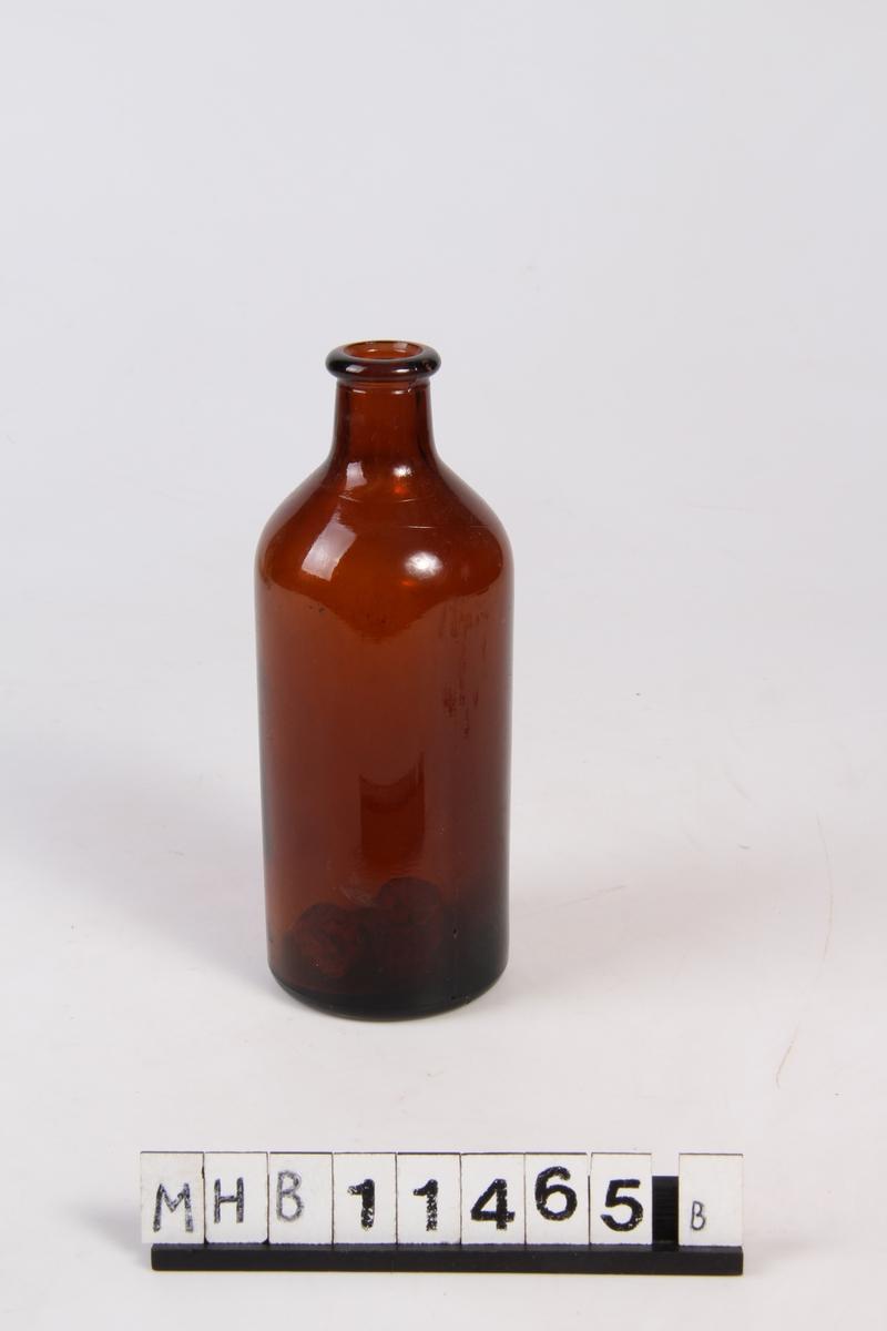 Brun glassflaske.