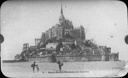 Skioptikonbild med tryckt motiv av Mont-Saint-Michel. Bilde