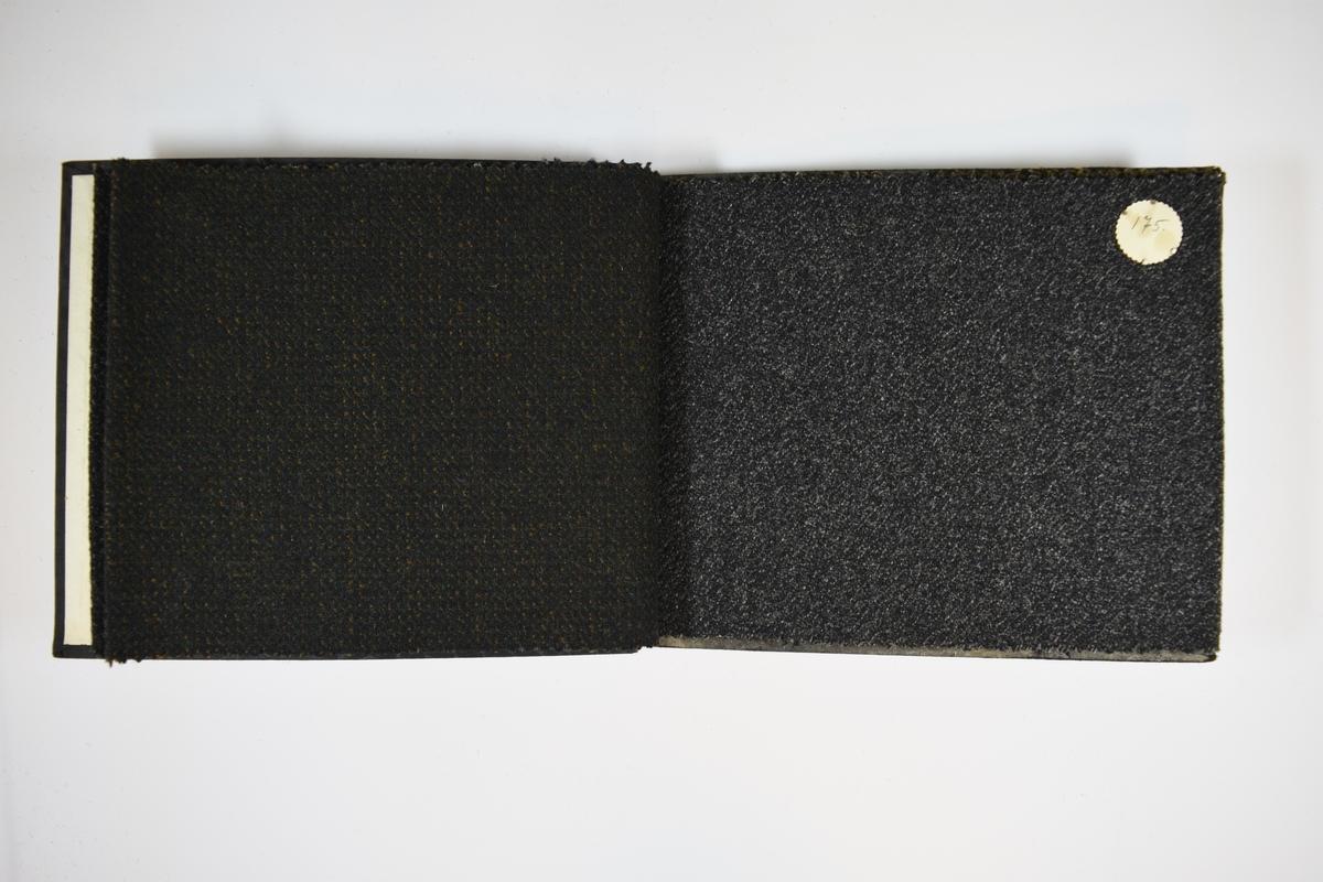 Prøvebok med 4 stoffprøver av ulike kvalitetsnumre.  Middels tykke stoff med skrå striper eller prikker. Stoffene ligger brettet dobbelt slik at vranga skjules. Stoffene er merket med en rund papirlapp, festet til stoffet med metallstifter, hvor nummer er påført for hånd.   Stoff nr.: 180, 630, 175, 175B.