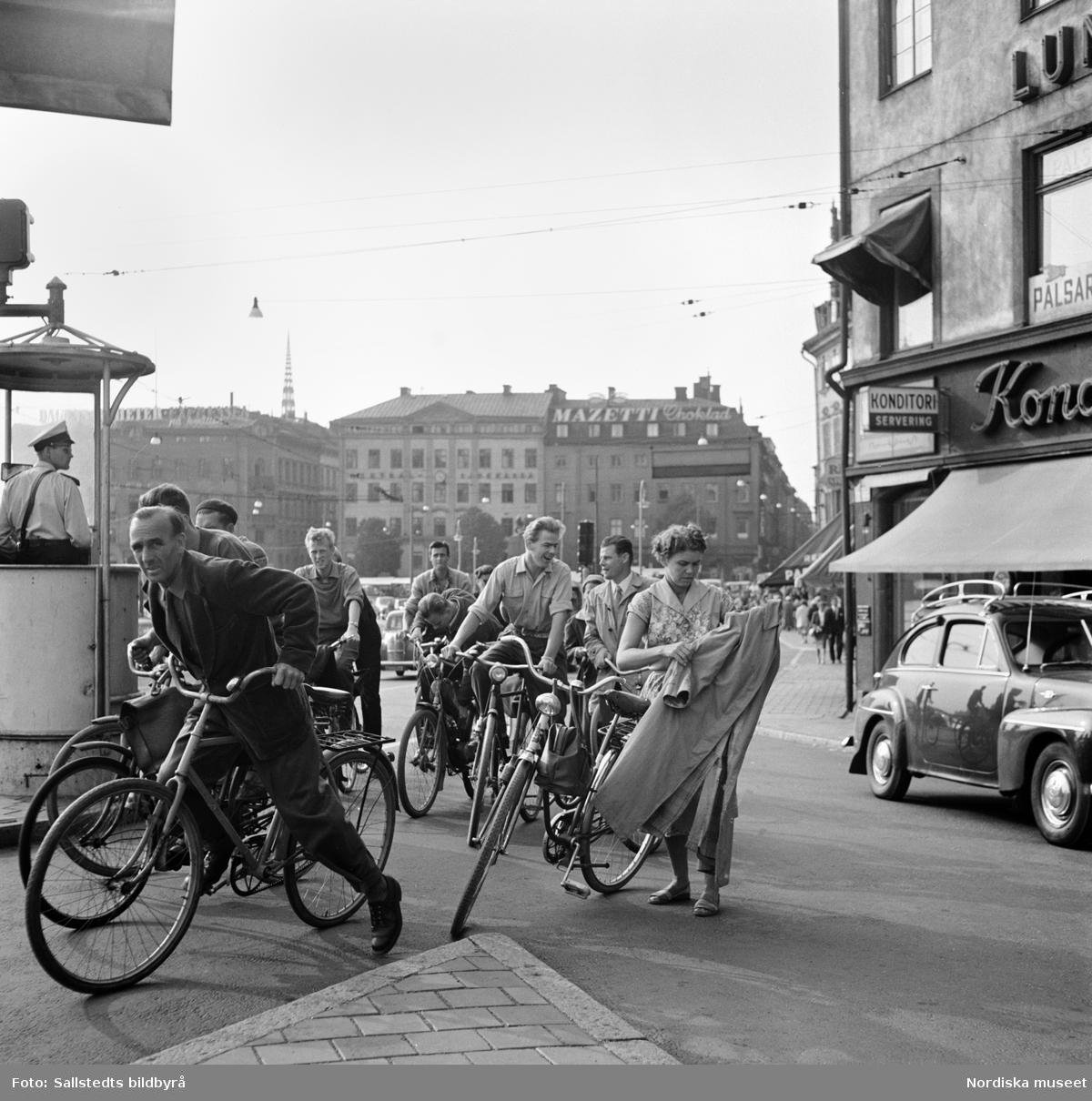 """Cyklister vid Slussen."" Stockholm."