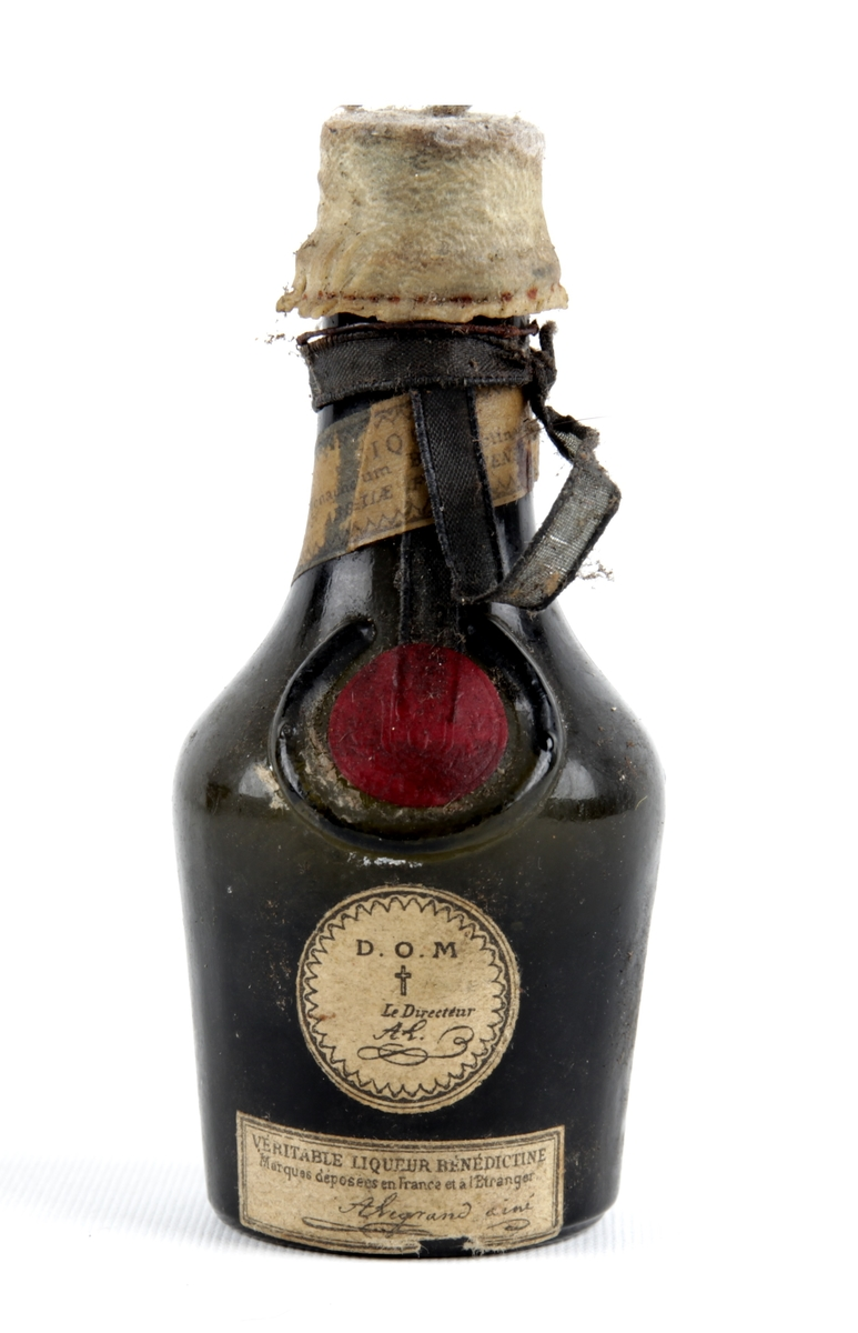Liten likørflaske med forseglet kork.