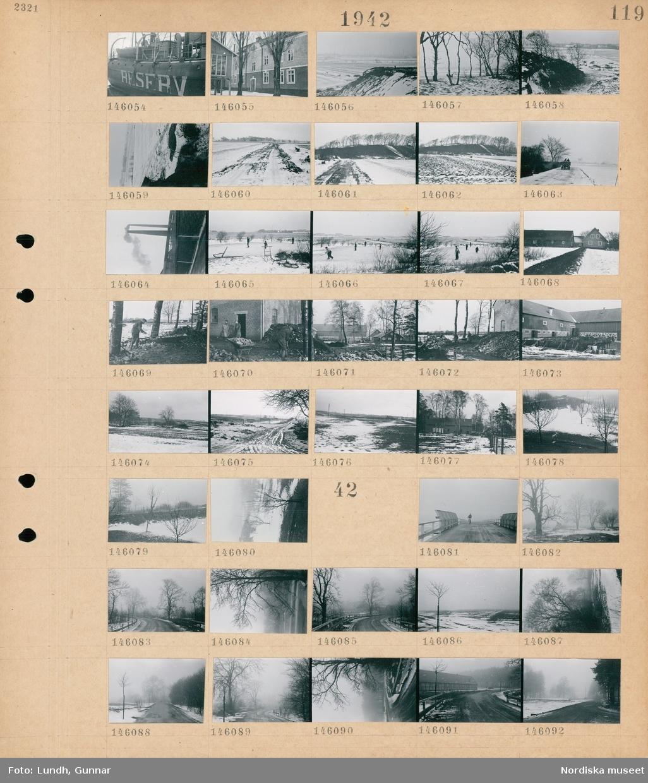 """Motiv: (ingen anteckning) ; Ett fyrfskepp med text """"Reserv"""" på sidan, exteriör av hus, landskapsvy med åkrar och kullar med snö på marken, en hästdragen vagn kör på en väg, industriskorstenar, barn spelar bandy på isen på damm med åkrar i bakgrunden, exteriör av en bondgård, en man med en skottkärra, två män står vid en tegelbyggnad, landskapsvy med åkrar och väg med snö.  Motiv: (ingen anteckning) ; En peson cyklar över en bro, landskapsvy med åkrar - träd och väg i snöslask och dimma."""