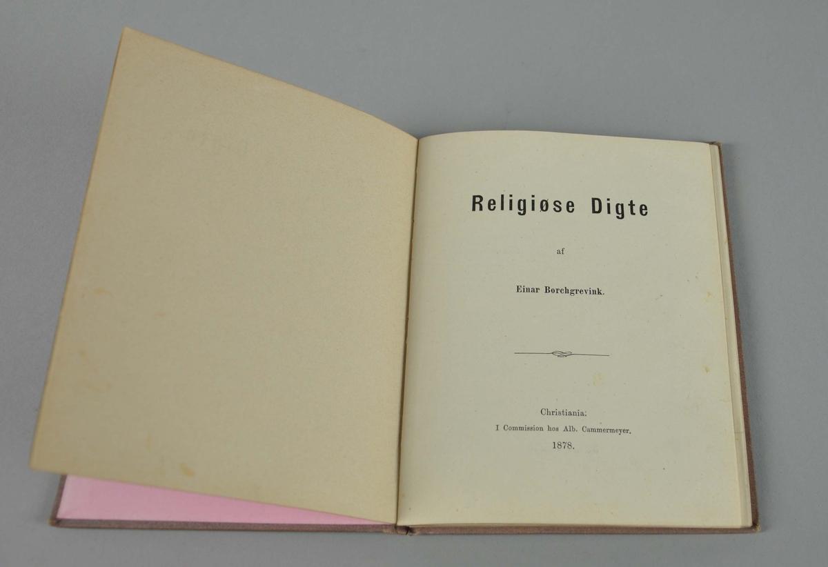 Diktbok med brodert omslag. Motiv på broderi av hund liggende ved et keltisk kors. 59 sider.  .
