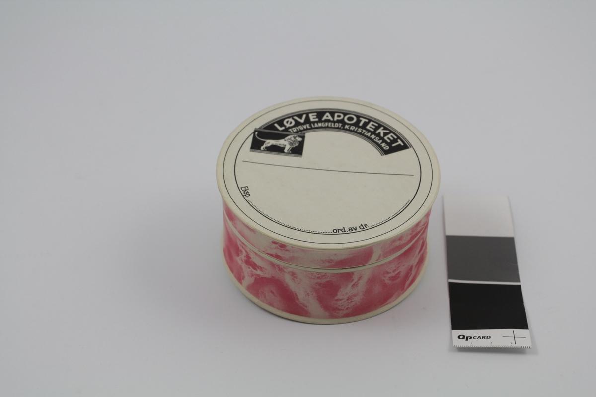 Sirkelformet eske med lokk, av papp, rosa. Brukt til piller og dosert pulver.